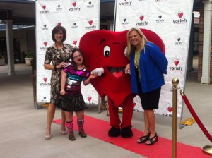 Spreading cheer at a fundraiser for Variety Children's Charities of KC.