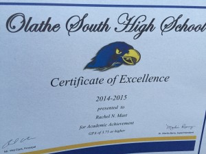 Rachel received an award at the Olathe South Academic Awards program. We were at BWW :(