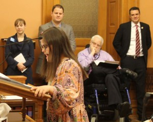 Rachel testifying on behalf of KS ABLE legislation. Congressman Kevin Yoder (R-KS) is watching on the side.