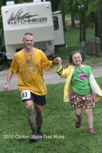 Ultra man's routine - crossing the finish line with his girl.